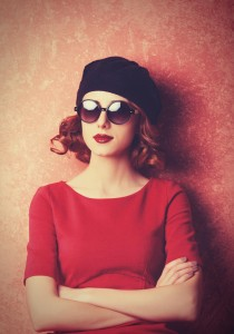http://www.dreamstime.com/royalty-free-stock-photos-redhead-sunglasses-red-background-image36470298